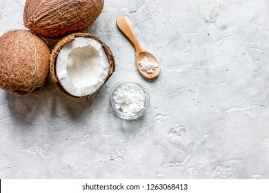 fresh coconut with cosmetic oil in jar on gray background top vi