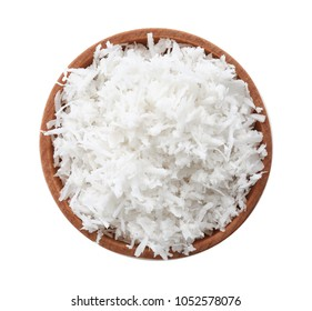 Fresh coconut flakes in bowl on white background, top view