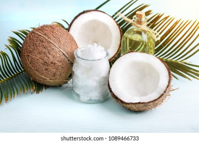 Fresh coconut milk and oil on wooden table background