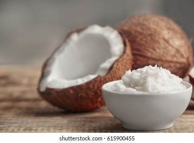Fresh coconut oil in bowl on wooden table