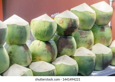 Fresh Coconut Prepare to Drink arranged display on shelf in Market Fresh Food Concept