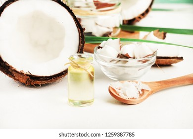 Fresh Coconut product for beauty care homemade, bottles on table with Coconut oil, fruit flesh. Organic skin care.