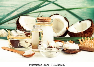 Fresh coconut pulp pieces in jars, coconut oil bottles, homemade nut milk, organic cosmetic beauty products for hair and body care.