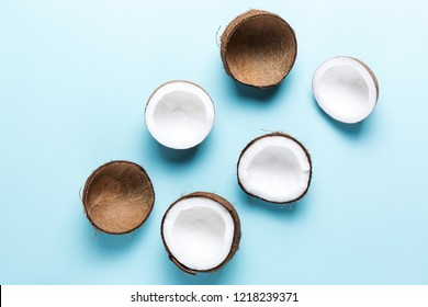 Fresh coconuts on a blue background