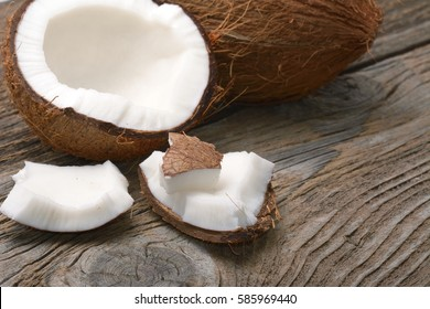 fresh coconuts on old wooden table