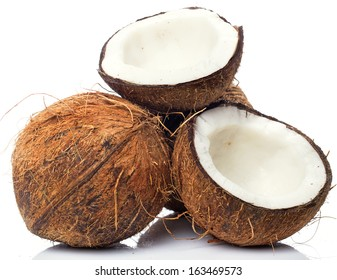 Fresh coconuts on white background