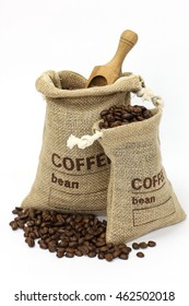 Fresh coffee beans in a bag with scoop on white background