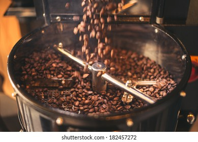 Fresh Coffee Beans - Freshly roasted 100% Arabica coffee beans falling into a spinning cooler professional machine.