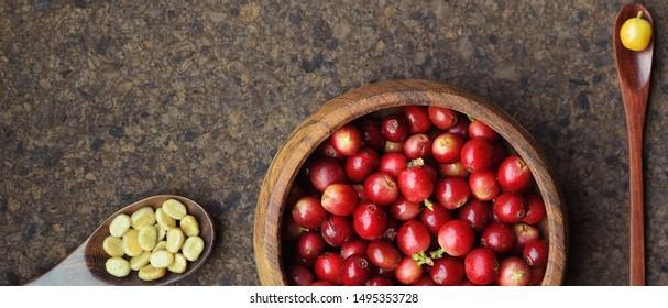 fresh coffee beans in wooden bowl on wooden background