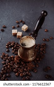 Fresh coffee in cezve with  coffee beans