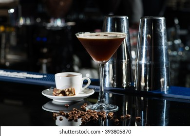 Fresh coffee cocktail with coffee beans and espresso at the bar counter in the night club.