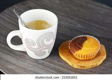 Fresh coffee on a dark wooden background