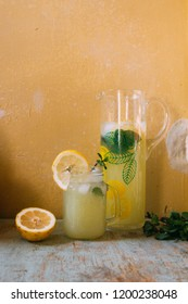 Fresh cold and bright lemonade with mint in a jar on the concrete background
