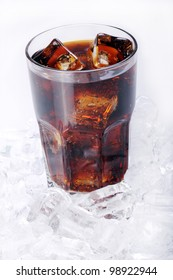 Fresh and cold cola drink in glass