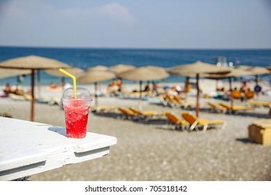 fresh cold slushy drink on summer beach