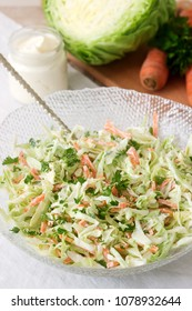 Fresh coleslaw salad in bowl and ingredients for salad. Rustic style.