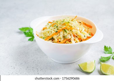 Fresh coleslaw salad in white bowl.