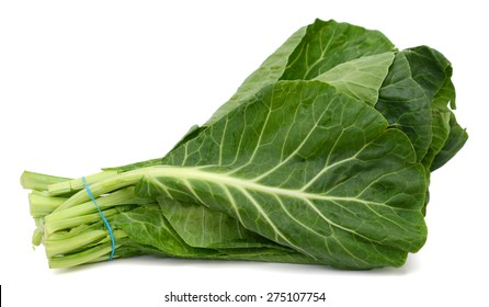 fresh collard leaves on white background