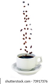 Fresh Colombian Coffee Beans Falling Into A Freshly Brewed Cup Of Coffee, Concept For Fresh Brewed Coffee
