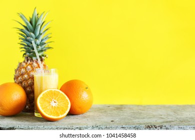 Fresh Color Juice Smoothie in Glass with Straw from Tropical Fruits Pine Apple Orange Yellow Background Diet Concept