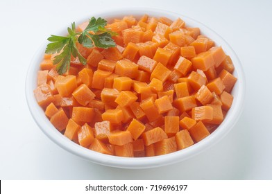 Fresh and colorful dish full of diced carrot ready to cook