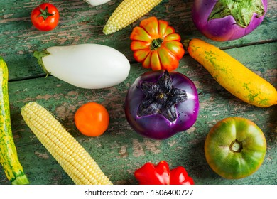 Fresh colorful organic season vegetables ingredients on rustic wooden background, top view, flat lay. Healthy, diet or vegetarian food concept.