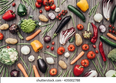 Fresh colorful organic vegetables on a rustic wooden table background, farming and healthy food concept