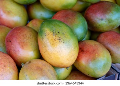 Fresh colorful tropical mangoes on display at outdoor farmers market at little India, street market, Singapore , close up, mango background