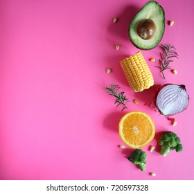 Fresh and colorful vegetables and fruits on a pink background. Space for text. Top view.