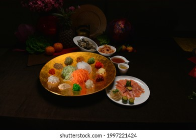 fresh colourful vegetables salad lo hei yu sheng with smoked salmon and sauces for chinese new year menu