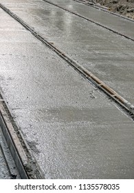Fresh concrete slab poured for new tramway track