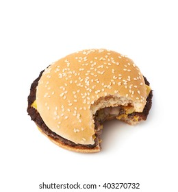 Fresh cooked hamburger with a single bite taken, composition isolated over the white background