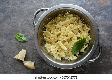 fresh cooked pasta in colander, cooking food