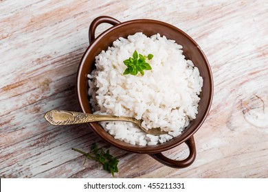 Fresh cooked rice in a bowl on wooden table