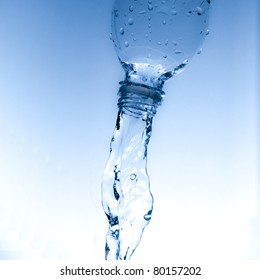 Fresh cool water pouring from a clean plastic water bottle