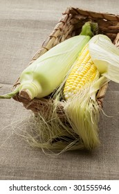fresh corn in the basket on the table