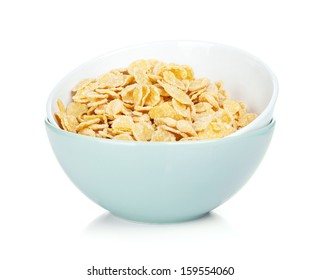 Fresh corn flakes in bowl. Isolated on white background