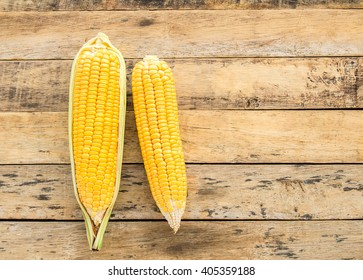 Fresh corn on a wooden table background
