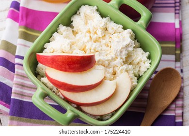 Fresh cottage cheese  in bowl with apple.  Rustic style. Bio/organic/natural ingredients. Healthy eating.