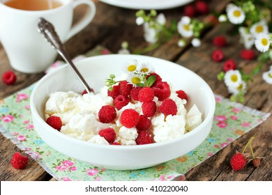 Fresh cottage cheese with juicy berries raspberries, dietary breakfast for summer time selective focus