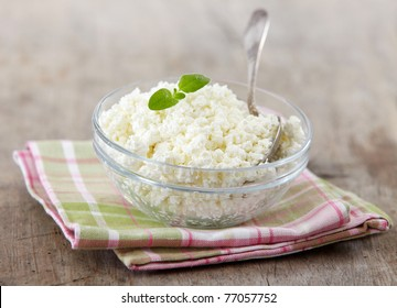 fresh cottage cheese on old wooden table