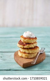 fresh cottage cheese pancakes on wooden surface