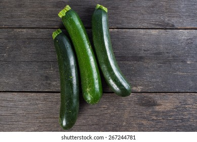 fresh courgettes on wooden rustic  table from above