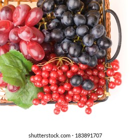 Fresh cranberries and grapes in basket isolated on white background