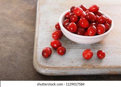 fresh cranberries in white dish