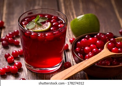 Fresh cranberry drink on wooden background