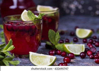 fresh cranberry juice in a glass with fresh mint and lime