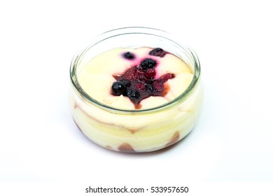 A fresh cream chantily with  blackberries, raspberries, and blueberries in a glass cup on a white background