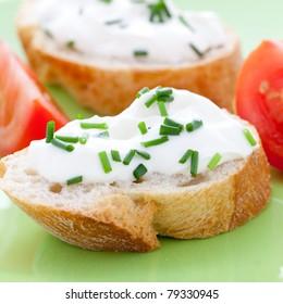 fresh cream cheese on baguette