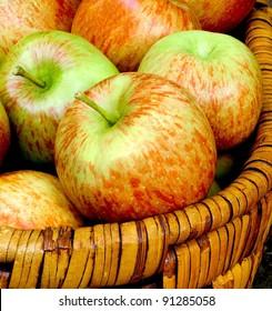 Fresh crisp apples in a basket.  Close up detail.